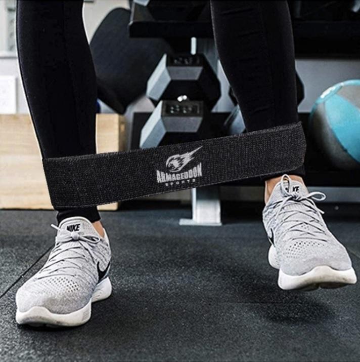 Armageddon Sports Черен тренировъчен ластик от текстил за тренировка на крака 16-22 кг